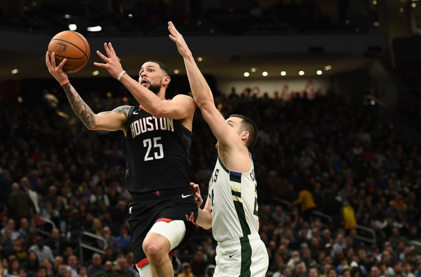 MILWAUKEE, WISCONSIN - MARCH 26: Austin Rivers #25 of the Houston Rockets drives to the basket against Pat Connaughton #24 of the Milwaukee Bucks during a game at Fiserv Forum on March 26, 2019 in Milwaukee, Wisconsin. NOTE TO USER: User expressly acknowledges and agrees that, by downloading and or using this photograph, User is consenting to the terms and conditions of the Getty Images License Agreement. (Photo by Stacy Revere/Getty Images)