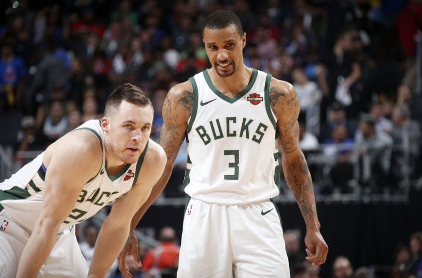 DETROIT, MI - APRIL 22: Pat Connaughton #24 and George Hill #3 of the Milwaukee Bucks look on against the Detroit Pistons during Game Four of Round One of the 2019 NBA Playoffs on April 22, 2019 at Little Caesars Arena in Detroit, Michigan. NOTE TO USER: User expressly acknowledges and agrees that, by downloading and/or using this photograph, user is consenting to the terms and conditions of the Getty Images License Agreement. Mandatory Copyright Notice: Copyright 2019 NBAE (Photo by Brian Sevald/NBAE via Getty Images)