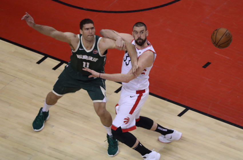 TORONTO, ON- MAY 19 - Milwaukee Bucks center Brook Lopez (11) and Toronto Raptors center Marc Gasol (33) battle for a loose ball as the Toronto Raptors beat the Milwaukee Bucks 118-112 in double overtime in the Eastern Conference NBA Final at Scotiabank Arena in Toronto. May 19, 2019. (Steve Russell/Toronto Star via Getty Images)