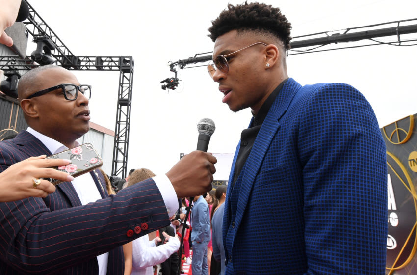SANTA MONICA, CA - JUNE 24: Caron Butler interviews Giannis Antetokounmpo #34 of the Milwaukee Bucks before the 2019 NBA Awards Show on June 24, 2019 at Barker Hangar in Santa Monica, California. NOTE TO USER: User expressly acknowledges and agrees that, by downloading and/or using this photograph, user is consenting to the terms and conditions of the Getty Images License Agreement. Mandatory Copyright Notice: Copyright 2019 NBAE (Photo by Andrew D. Bernstein/NBAE via Getty Images)