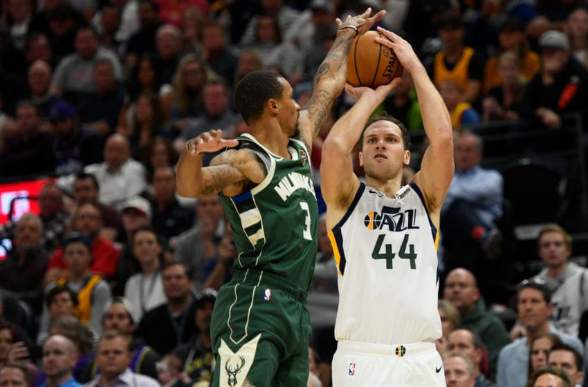 SALT LAKE CITY, UT - NOVEMBER 08: Bojan Bogdanovic #44 of the Utah Jazz shoots over George Hill #3 of the Milwaukee Bucks during a game at Vivint Smart Home Arena on November 8, 2019 in Salt Lake City, Utah. NOTE TO USER: User expressly acknowledges and agrees that, by downloading and/or using this photograph, user is consenting to the terms and conditions of the Getty Images License Agreement. (Photo by Alex Goodlett/Getty Images)