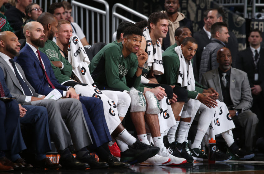 MILWAUKEE, WI - DECEMBER 6: Giannis Antetokounmpo #34 of the Milwaukee Bucks smiles on the bench against the LA Clippers on December 6, 2019 at the Fiserv Forum Center in Milwaukee, Wisconsin. NOTE TO USER: User expressly acknowledges and agrees that, by downloading and or using this Photograph, user is consenting to the terms and conditions of the Getty Images License Agreement. Mandatory Copyright Notice: Copyright 2019 NBAE (Photo by Gary Dineen/NBAE via Getty Images).