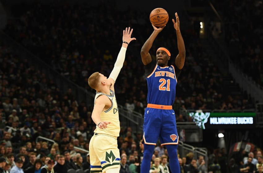 MILWAUKEE, WISCONSIN - DECEMBER 02: Damyean Dotson #21 of the New York Knicks shoots over Donte DiVincenzo #0 of the Milwaukee Bucks during the second half at Fiserv Forum on December 02, 2019 in Milwaukee, Wisconsin. NOTE TO USER: User expressly acknowledges and agrees that, by downloading and or using this photograph, User is consenting to the terms and conditions of the Getty Images License Agreement. (Photo by Stacy Revere/Getty Images)