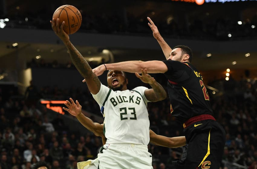 MILWAUKEE, WISCONSIN - DECEMBER 14: Sterling Brown #23 of the Milwaukee Bucks is fouled by Larry Nance Jr. #22 of the Cleveland Cavaliers during the second half of a game at Fiserv Forum on December 14, 2019 in Milwaukee, Wisconsin. NOTE TO USER: User expressly acknowledges and agrees that, by downloading and or using this photograph, User is consenting to the terms and conditions of the Getty Images License Agreement. (Photo by Stacy Revere/Getty Images)