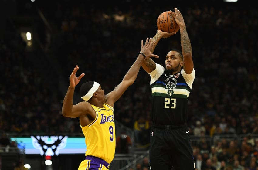 MILWAUKEE, WISCONSIN - DECEMBER 19: Sterling Brown #23 of the Milwaukee Bucks shoots over Rajon Rondo #9 of the Los Angeles Lakers during a game at Fiserv Forum on December 19, 2019 in Milwaukee, Wisconsin. NOTE TO USER: User expressly acknowledges and agrees that, by downloading and or using this photograph, User is consenting to the terms and conditions of the Getty Images License Agreement. (Photo by Stacy Revere/Getty Images)