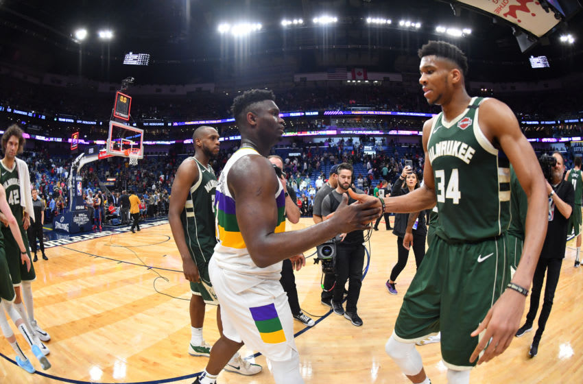 NEW ORLEANS, LA - FEBRUARY 4: Zion Williamson #1 of the New Orleans Pelicans and Giannis Antetokounmpo #34 of the Milwaukee Bucks high-five after a game on February 4, 2020 at the Smoothie King Center in New Orleans, Louisiana. NOTE TO USER: User expressly acknowledges and agrees that, by downloading and or using this Photograph, user is consenting to the terms and conditions of the Getty Images License Agreement. Mandatory Copyright Notice: Copyright 2020 NBAE (Photo by Jesse D. Garrabrant/NBAE via Getty Images)