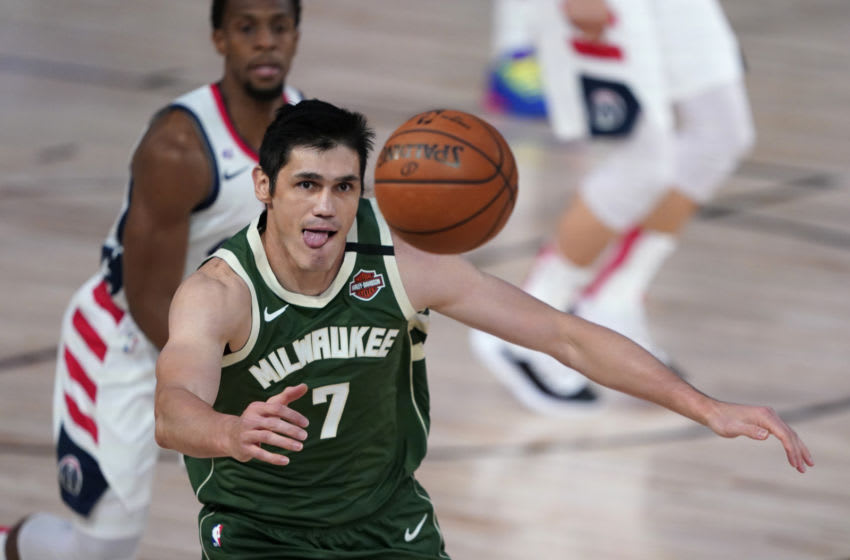 LAKE BUENA VISTA, FLORIDA - AUGUST 11: Ersan Ilyasova #7 of the Milwaukee Bucks chases after the loose ball during the first half against the Washington Wizards at Visa Athletic Center at ESPN Wide World Of Sports Complex on August 11, 2020 in Lake Buena Vista, Florida. NOTE TO USER: User expressly acknowledges and agrees that, by downloading and or using this photograph, User is consenting to the terms and conditions of the Getty Images License Agreement. (Photo by Ashley Landis - Pool/Getty Images)