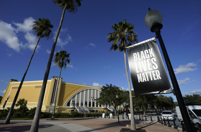 LAKE BUENA VISTA, FLORIDA - AUGUST 26: A Black Lives Matter banner hangs outside of the arena after a postponed NBA basketball first round playoff game between the Milwaukee Bucks and the Orlando Magic at AdventHealth Arena at ESPN Wide World Of Sports Complex on August 26, 2020 in Lake Buena Vista, Florida. According to reports, the Milwaukee Bucks have boycotted their game 5 playoff game against the Orlando Magic to protest the shooting of Jacob Blake by Kenosha, Wisconsin police. NOTE TO USER: User expressly acknowledges and agrees that, by downloading and or using this photograph, User is consenting to the terms and conditions of the Getty Images License Agreement. (Photo by Ashley Landis-Pool/Getty Images)