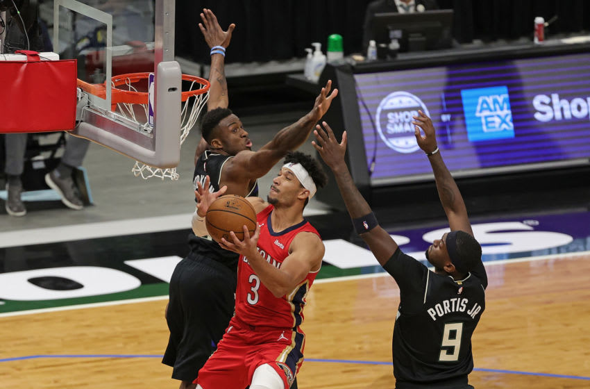 MILWAUKEE, WISCONSIN - FEBRUARY 25: Josh Hart #3 of the New Orleans Pelicans drives to the basket between Thanasis Antetokounmpo #43 and Bobby Portis #9 of the Milwaukee Bucks during a game at Fiserv Forum on February 25, 2021 in Milwaukee, Wisconsin. NOTE TO USER: User expressly acknowledges and agrees that, by downloading and or using this photograph, User is consenting to the terms and conditions of the Getty Images License Agreement (Photo by Stacy Revere/Getty Images)