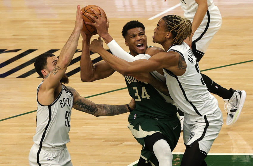 MILWAUKEE, WISCONSIN - JUNE 10: Giannis Antetokounmpo #34 of the Milwaukee Bucks is defended by Nicolas Claxton #33 and Mike James #55 of the Brooklyn Nets during the first half of Game Three of the Eastern Conference second round playoff series at the Fiserv Forum on June 10, 2021 in Milwaukee, Wisconsin. NOTE TO USER: User expressly acknowledges and agrees that, by downloading and or using this photograph, User is consenting to the terms and conditions of the Getty Images License Agreement. (Photo by Stacy Revere/Getty Images)