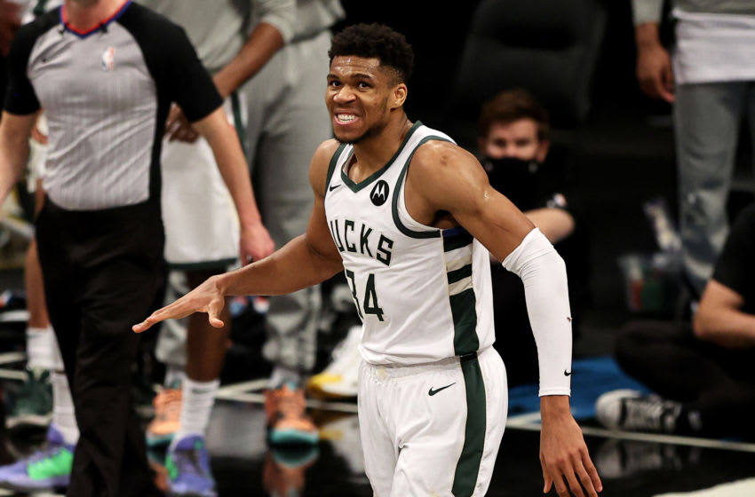 NEW YORK, NEW YORK - JUNE 15: Giannis Antetokounmpo #34 of the Milwaukee Bucks reacts after he was called for a foul in the fourth quarter against the Brooklyn Nets during game 5 of the Eastern Conference second round at Barclays Center on June 15, 2021 in the Brooklyn borough of New York City. NOTE TO USER: User expressly acknowledges and agrees that, by downloading and or using this photograph, User is consenting to the terms and conditions of the Getty Images License Agreement. (Photo by Elsa/Getty Images)