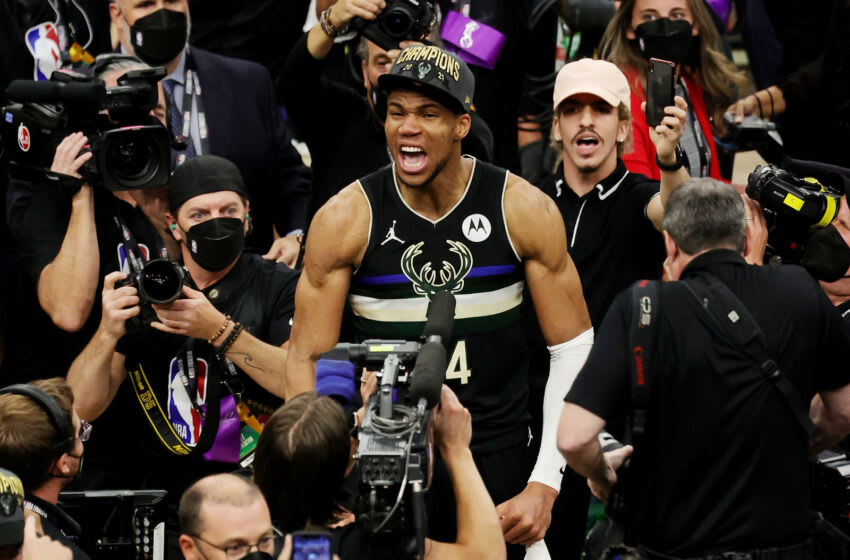 MILWAUKEE, WISCONSIN - JULY 20: Giannis Antetokounmpo #34 of the Milwaukee Bucks celebrates defeating the Phoenix Suns in Game Six to win the 2021 NBA Finals at Fiserv Forum on July 20, 2021 in Milwaukee, Wisconsin. NOTE TO USER: User expressly acknowledges and agrees that, by downloading and or using this photograph, User is consenting to the terms and conditions of the Getty Images License Agreement. (Photo by Jonathan Daniel/Getty Images)