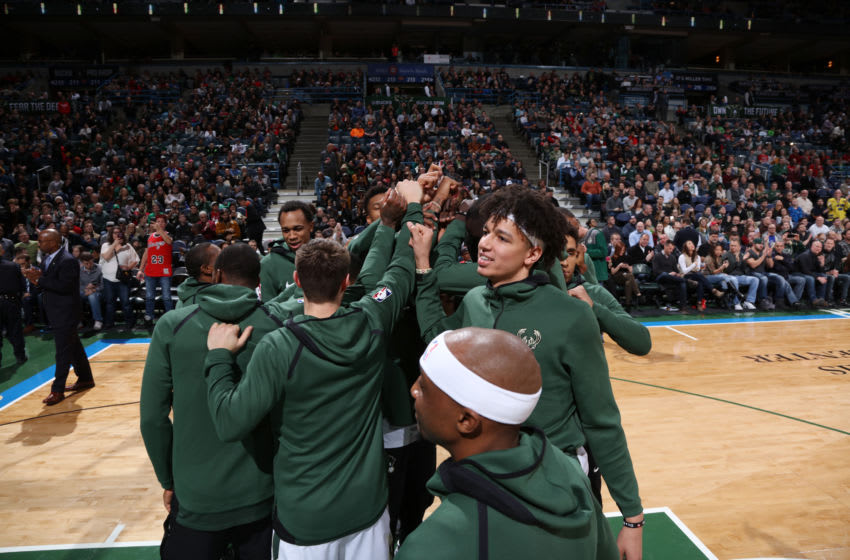MILWAUKEE, WI - DECEMBER 26: D.J. Wilson #5 of the Milwaukee Bucks with his teammates huddle before the game against the Chicago Bulls on December 26, 2017 at the BMO Harris Bradley Center in Milwaukee, Wisconsin. NOTE TO USER: User expressly acknowledges and agrees that, by downloading and or using this Photograph, user is consenting to the terms and conditions of the Getty Images License Agreement. Mandatory Copyright Notice: Copyright 2017 NBAE (Photo by Gary Dineen/NBAE via Getty Images)