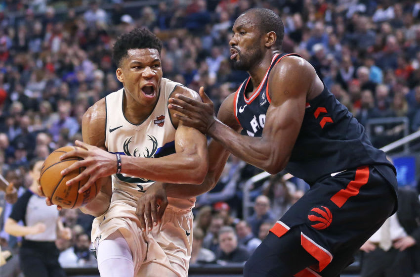 TORONTO, ON - FEBRUARY 23: Giannis Antetokounmpo #34 of the Milwaukee Bucks drives the ball against Serge Ibaka #9 of the Toronto Raptors in an NBA game at the Air Canada Centre on February 23, 2018 in Toronto, Ontario, Canada. The Bucks defeated the Raptors 122-119 in overtime. NOTE TO USER: user expressly acknowledges and agrees by downloading and/or using this Photograph, user is consenting to the terms and conditions of the Getty Images Licence Agreement. (Photo by Claus Andersen/Getty Images)