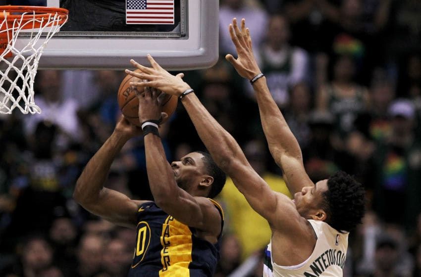 MILWAUKEE, WI - MARCH 02: Giannis Antetokounmpo #34 of the Milwaukee Bucks blocks a shot attempt by Glenn Robinson III #40 of the Indiana Pacers in the first quarter at the Bradley Center on March 2, 2018 in Milwaukee, Wisconsin. NOTE TO USER: User expressly acknowledges and agrees that, by downloading and or using this photograph, User is consenting to the terms and conditions of the Getty Images License Agreement. (Photo by Dylan Buell/Getty Images)