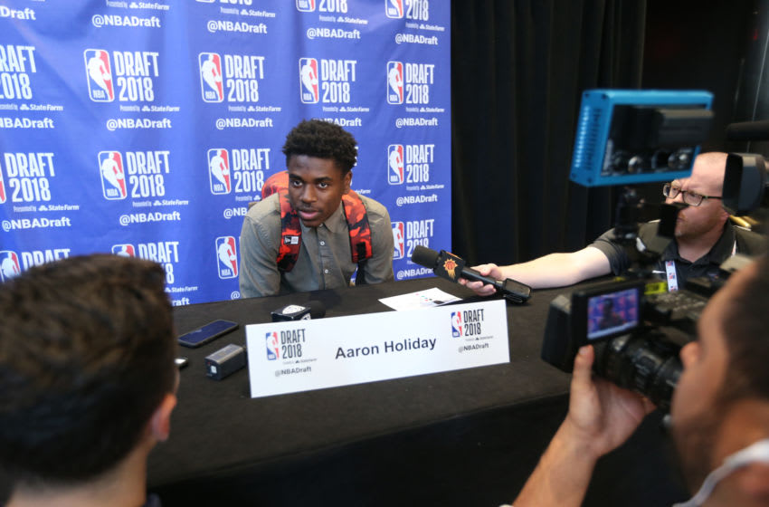 NEW YORK - JUNE 20: NBA Draft Prospect, Aaron Holiday speaks to the media during media availability and circuit as part of the 2018 NBA Draft on June 20, 2018 at the Grand Hyatt New York in New York City. NOTE TO USER: User expressly acknowledges and agrees that, by downloading and/or using this photograph, user is consenting to the terms and conditions of the Getty Images License Agreement. Mandatory Copyright Notice: Copyright 2018 NBAE (Photo by Michelle Farsi/NBAE via Getty Images)