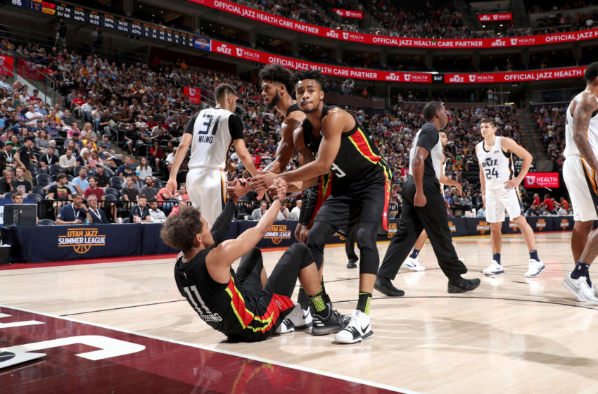 SALT LAKE CITY, UT - JULY 5: Tyler Dorsey #2 and Jaylen Morris #3 help up Trae Young #11 of the Atlanta Hawks during the game against the Utah Jazz on July 5, 2018 at Vivint Smart Home Arena in Salt Lake City, Utah. NOTE TO USER: User expressly acknowledges and agrees that, by downloading and/or using this photograph, user is consenting to the terms and conditions of the Getty Images License Agreement. Mandatory Copyright Notice: Copyright 2018 NBAE (Photo by Joe Murphy/NBAE via Getty Images)