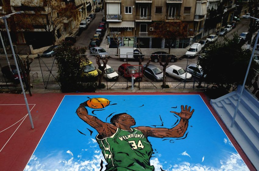 A picture taken on February 19, 2017, shows an artwork by street artist Same84 depicting Milwaukee Bucks' Greek basketball player Giannis Antetokounmpo on a basketball court in Athens. Greek NBA player Giannis Antetokounmpo began playing basketball in an open field in Athens neighbourhood of Sepolia. He was drafted number 15 in the NBA in 2013 and now participates in his first All Star Game. / AFP / Angelos TZORTZINIS / RESTRICTED TO EDITORIAL USE - MANDATORY MENTION OF THE ARTIST UPON PUBLICATION - TO ILLUSTRATE THE EVENT AS SPECIFIED IN THE CAPTION (Photo credit should read ANGELOS TZORTZINIS/AFP/Getty Images)