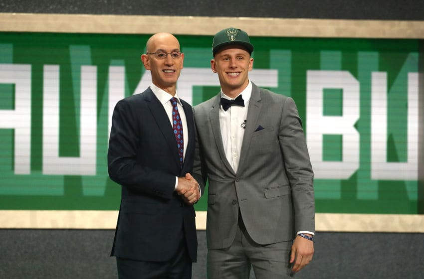 NEW YORK, NY - JUNE 21: Donte DiVincenzo poses with NBA Commissioner Adam Silver after being drafted 17th overall by the Milwaukee Bucks during the 2018 NBA Draft at the Barclays Center on June 21, 2018 in the Brooklyn borough of New York City. NOTE TO USER: User expressly acknowledges and agrees that, by downloading and or using this photograph, User is consenting to the terms and conditions of the Getty Images License Agreement. (Photo by Mike Stobe/Getty Images)