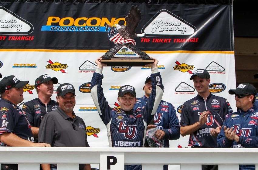 Jul 30, 2016; Long Pond, PA, USA; NASCAR Camping World Truck Series driver William Byron raises the trophy in victory lane after winning the Pocono Mountains 150 at Pocono Raceway. Mandatory Credit: Matthew O