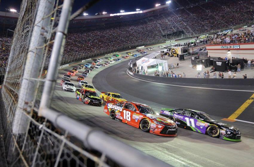 Aug 22, 2015; Bristol, TN, USA; NASCAR Sprint Cup Series driver Kyle Busch (18) and Denny Hamlin (11) Irwin Tools Night Race at Bristol Motor Speedway. Mandatory Credit: Randy Sartin-USA TODAY Sports