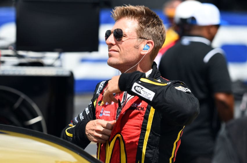 DARLINGTON, SC - SEPTEMBER 01: Jamie McMurray, driver of the #1 McDonald's 50 Years of Big Mac Chevrolet, stands on the grid during qualifying for the Monster Energy NASCAR Cup Series Bojangles' Southern 500 at Darlington Raceway on September 1, 2018 in Darlington, South Carolina. (Photo by Josh Hedges/Getty Images)