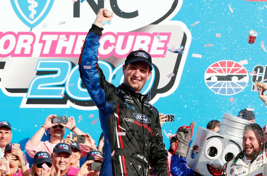 CHARLOTTE, NC - SEPTEMBER 29: Chase Briscoe, driver of the #98 Nutri Chomps/Ford Ford, celebrates in victory lane after winning the NASCAR XFINITY Series Drive for the Cure 200 at Charlotte Motor Speedway on September 29, 2018 in Charlotte, North Carolina. (Photo by Brian Lawdermilk/Getty Images)