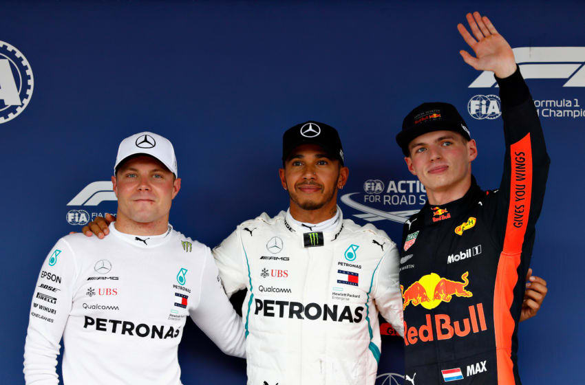 SUZUKA, JAPAN - OCTOBER 06: Top three qualifiers Lewis Hamilton of Great Britain and Mercedes GP, Valtteri Bottas of Finland and Mercedes GP and Max Verstappen of Netherlands and Red Bull Racing celebrate in parc ferme during qualifying for the Formula One Grand Prix of Japan at Suzuka Circuit on October 6, 2018 in Suzuka. (Photo by Will Taylor-Medhurst/Getty Images)