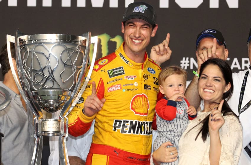 HOMESTEAD, FL - NOVEMBER 18: Joey Logano, driver of the #22 Shell Pennzoil Ford, celebrates with his wife, Brittany, and son, Hudson, after winning the Monster Energy NASCAR Cup Series Ford EcoBoost 400 at Homestead-Miami Speedway on November 18, 2018 in Homestead, Florida. (Photo by Chris Graythen/Getty Images)