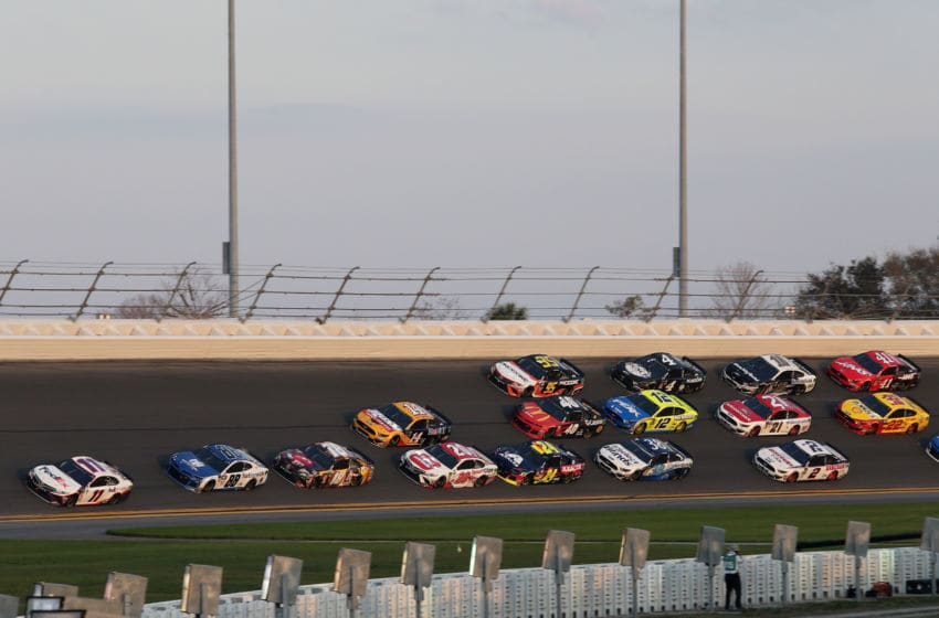 DAYTONA BEACH, FL - FEBRUARY 17: Denny Hamlin, driver of the #11 FedEx Express Toyota, leads a pack of cars during the Monster Energy NASCAR Cup Series 61st Annual Daytona 500 at Daytona International Speedway on February 17, 2019 in Daytona Beach, Florida. (Photo by Jerry Markland/Getty Images)
