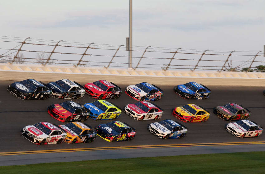 DAYTONA BEACH, FL - FEBRUARY 17: Erik Jones, driver of the #20 Sport Clips Toyota, leads a pack of cars during the Monster Energy NASCAR Cup Series 61st Annual Daytona 500 at Daytona International Speedway on February 17, 2019 in Daytona Beach, Florida. (Photo by Jerry Markland/Getty Images)