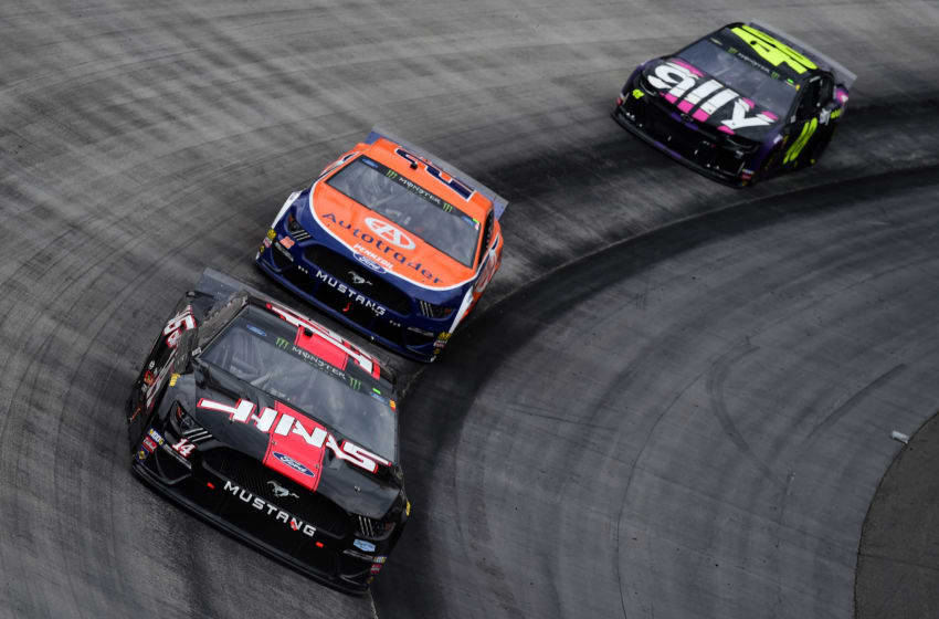 BRISTOL, TN - APRIL 07: Clint Bowyer, driver of the #14 Haas Automation Ford, leads Joey Logano, driver of the #22 Autotrader Ford, and Jimmie Johnson, driver of the #48 Ally Chevrolet, during the Monster Energy NASCAR Cup Series Food City 500 at Bristol Motor Speedway on April 7, 2019 in Bristol, Tennessee. (Photo by Jared C. Tilton/Getty Images)