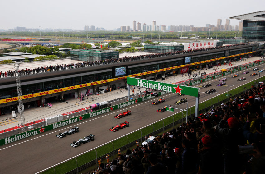 SHANGHAI, CHINA - APRIL 14: Lewis Hamilton of Great Britain driving the (44) Mercedes AMG Petronas F1 Team Mercedes W10, Valtteri Bottas driving the (77) Mercedes AMG Petronas F1 Team Mercedes W10, Sebastian Vettel of Germany driving the (5) Scuderia Ferrari SF90 and Charles Leclerc of Monaco driving the (16) Scuderia Ferrari SF90 battle for position off the line at the start during the F1 Grand Prix of China at Shanghai International Circuit on April 14, 2019 in Shanghai, China. (Photo by Charles Coates/Getty Images)