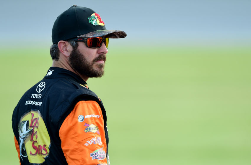 JOLIET, ILLINOIS - JUNE 29: Martin Truex Jr., driver of the #19 Bass Pro Shops Toyota, stands on the grid during qualifying for the Monster Energy NASCAR Cup Series Camping World 400 at Chicagoland Speedway on June 29, 2019 in Joliet, Illinois. (Photo by Jared C. Tilton/Getty Images)
