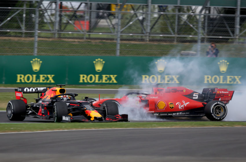 NORTHAMPTON, ENGLAND - JULY 14: Max Verstappen of the Netherlands driving the (33) Aston Martin Red Bull Racing RB15 and Sebastian Vettel of Germany driving the (5) Scuderia Ferrari SF90 crash during the F1 Grand Prix of Great Britain at Silverstone on July 14, 2019 in Northampton, England. (Photo by Charles Coates/Getty Images)