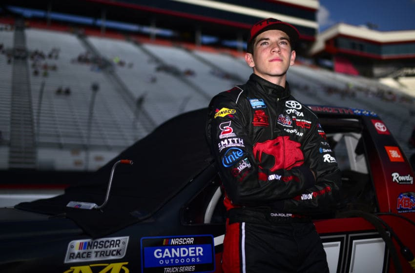 BRISTOL, TENNESSEE - AUGUST 15: Chandler Smith, driver of the #51 iBUYPOWER Toyota, stands on the grid during qualifying for the NASCAR Gander Outdoor Truck Series UNOH 200 presented by Ohio Logistics at Bristol Motor Speedway on August 15, 2019 in Bristol, Tennessee. (Photo by Jared C. Tilton/Getty Images)