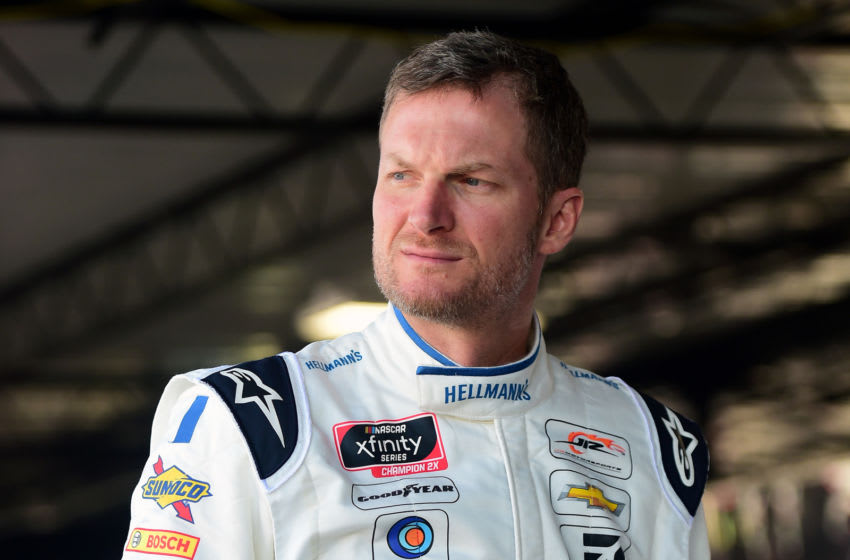 DARLINGTON, SOUTH CAROLINA - AUGUST 30: Dale Earnhardt Jr., driver of the #8 Hellmann's Chevrolet, stands in the garage area during practice for the NASCAR Xfinity Series Sport Clips Haircuts VFW 200 at Darlington Raceway on August 30, 2019 in Darlington, South Carolina. (Photo by Jared C. Tilton/Getty Images)