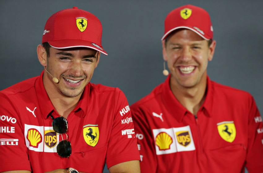 MONZA, ITALY - SEPTEMBER 05: Sebastian Vettel of Germany and Ferrari and Charles Leclerc of Monaco and Ferrari talk in the Drivers Press Conference during previews ahead of the F1 Grand Prix of Italy at Autodromo di Monza on September 05, 2019 in Monza, Italy. (Photo by Peter Fox/Getty Images)