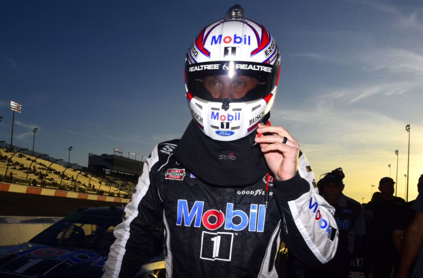 RICHMOND, VIRGINIA - SEPTEMBER 20: Kevin Harvick, driver of the #4 Mobil 1 Ford, walks on the grid during qualifying for the Monster Energy NASCAR Cup Series Federated Auto Parts 400 at Richmond Raceway on September 20, 2019 in Richmond, Virginia. (Photo by Jared C. Tilton/Getty Images)