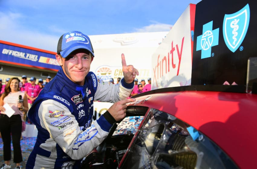 CHARLOTTE, NORTH CAROLINA - SEPTEMBER 28: A J Allmendinger, driver of the #10 Digital Ally Chevrolet, poses with the winner's decal on his car in Victory Lane after winning the NASCAR Xfinity Series Drive for the Cure 250 presented by Blue Cross Blue Shield of North Carolina at Charlotte Motor Speedway on September 28, 2019 in Charlotte, North Carolina. (Photo by Jared C. Tilton/Getty Images)
