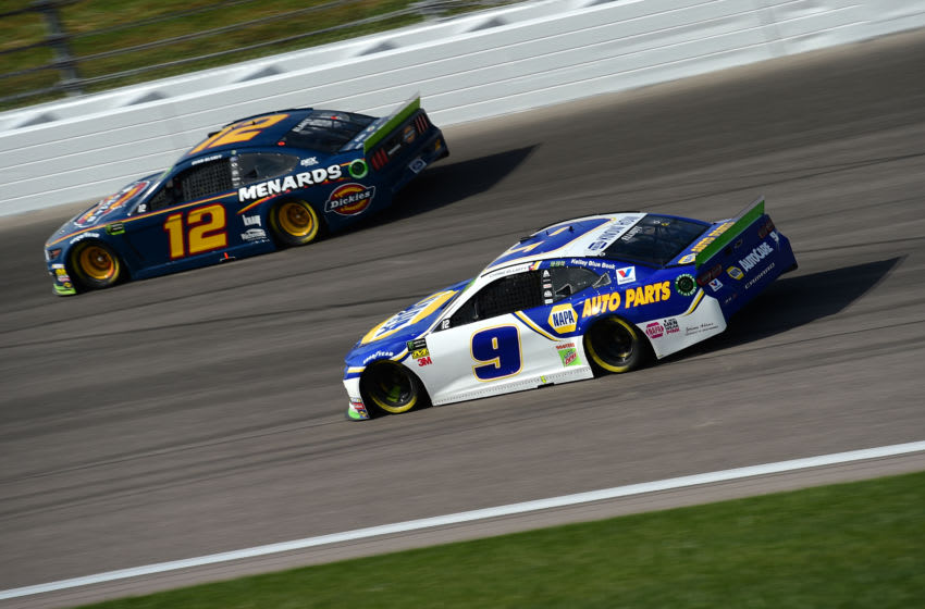 KANSAS CITY, KANSAS - OCTOBER 20: Chase Elliott, driver of the #9 NAPA Auto Parts Chevrolet, races Ryan Blaney, driver of the #12 Menards/Dickies Ford, during the Monster Energy NASCAR Cup Series Hollywood Casino 400 at Kansas Speedway on October 20, 2019 in Kansas City, Kansas. (Photo by Jared C. Tilton/Getty Images)
