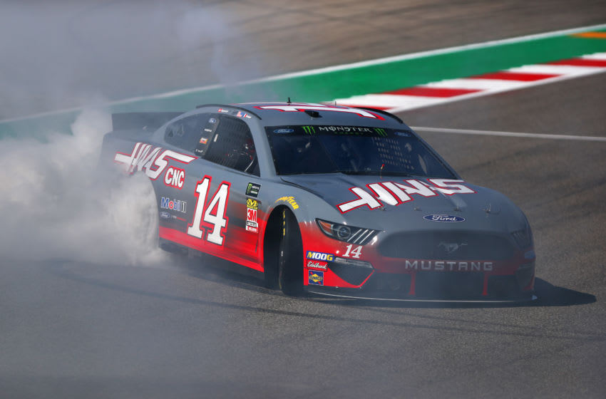 AUSTIN, TEXAS - OCTOBER 31: Romain Grosjean of France and Haas F1 performs donuts in the No.14 Haas Automation Ford Mustang in a demonstration run with Kevin Magnussen of Denmark and Haas F1 as a passenger during previews ahead of the F1 Grand Prix of USA at Circuit of The Americas on October 31, 2019 in Austin, Texas. (Photo by Dan Istitene/Getty Images)
