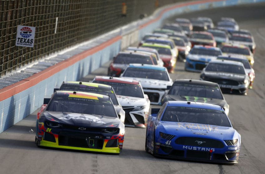 FORT WORTH, TEXAS - NOVEMBER 03: William Byron, driver of the #24 Axalta Chevrolet, and Daniel Suarez, driver of the #41 Walmart Family Mobile Ford, lead the field during the Monster Energy NASCAR Cup Series AAA Texas 500 at Texas Motor Speedway on November 03, 2019 in Fort Worth, Texas. (Photo by Jonathan Ferrey/Getty Images)