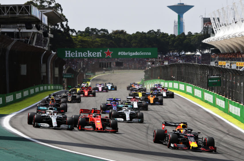 SAO PAULO, BRAZIL - NOVEMBER 17: Max Verstappen of the Netherlands driving the (33) Aston Martin Red Bull Racing RB15 leads the field into turn one at the start during the F1 Grand Prix of Brazil at Autodromo Jose Carlos Pace on November 17, 2019 in Sao Paulo, Brazil. (Photo by Mark Thompson/Getty Images)