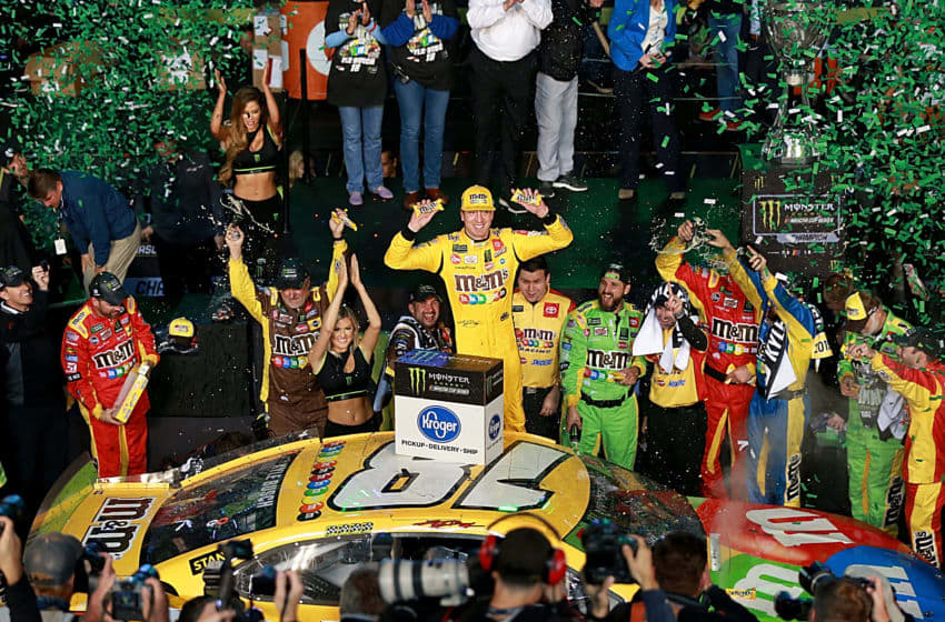 HOMESTEAD, FLORIDA - NOVEMBER 17: Kyle Busch, driver of the #18 M&M's Toyota, celebrates in victory lane after winning the Monster Energy NASCAR Cup Series Championship and the Monster Energy NASCAR Cup Series Ford EcoBoost 400 at Homestead Speedway on November 17, 2019 in Homestead, Florida. (Photo by Sean Gardner/Getty Images)