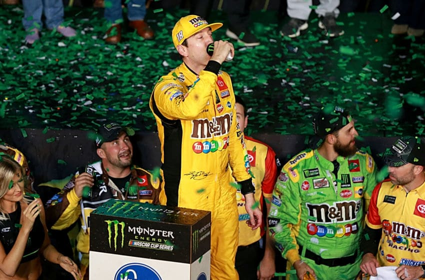 HOMESTEAD, FLORIDA - NOVEMBER 17: Kyle Busch, driver of the #18 M&M's Toyota, celebrates in Victory Lane after winning the Monster Energy NASCAR Cup Series Ford EcoBoost 400 and the Monster Energy NASCAR Cup Series Championship at Homestead Speedway on November 17, 2019 in Homestead, Florida. (Photo by Sean Gardner/Getty Images)