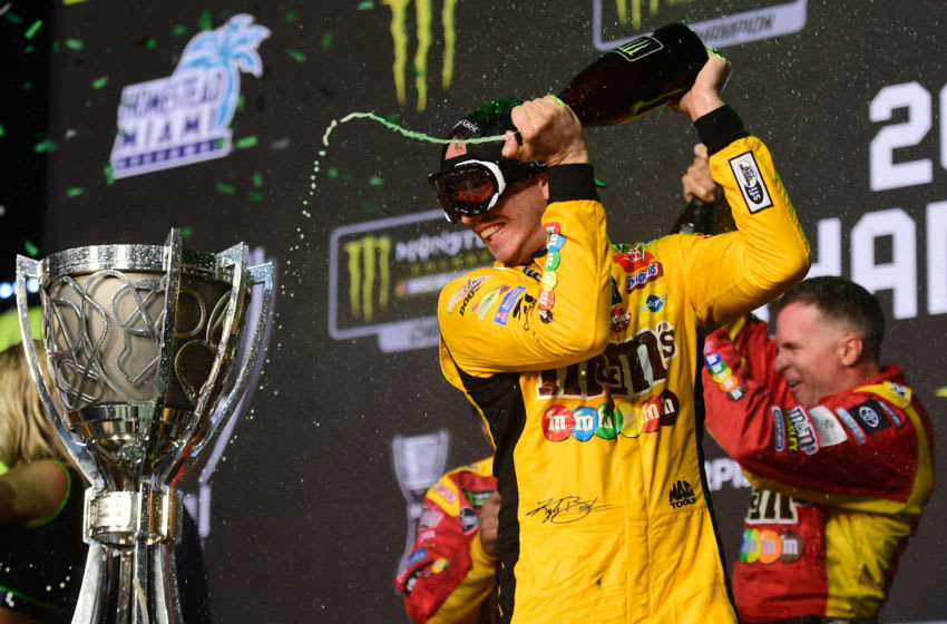 HOMESTEAD, FLORIDA - NOVEMBER 17: Kyle Busch, driver of the #18 M&M's Toyota, celebrates in Victory Lane after winning the Monster Energy NASCAR Cup Series Ford EcoBoost 400 and the Monster Energy NASCAR Cup Series Championship at Homestead Speedway on November 17, 2019 in Homestead, Florida. (Photo by Jared C. Tilton/Getty Images)