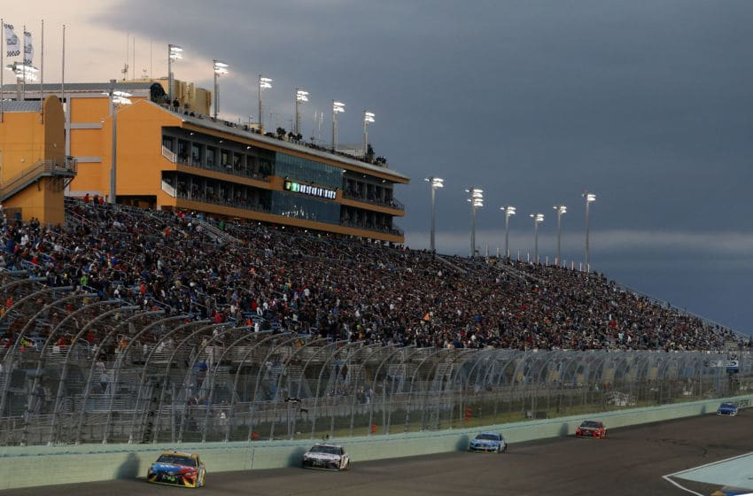 HOMESTEAD, FLORIDA - NOVEMBER 17: Kyle Busch, driver of the #18 M&M's Toyota, leads a pack of cars during the Monster Energy NASCAR Cup Series Ford EcoBoost 400 at Homestead Speedway on November 17, 2019 in Homestead, Florida. (Photo by Brian Lawdermilk/Getty Images)
