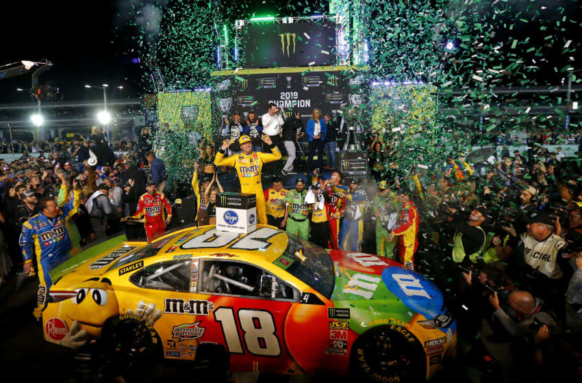 HOMESTEAD, FLORIDA - NOVEMBER 17: Kyle Busch, driver of the #18 M&M's Toyota, celebrates in Victory Lane after winning the Monster Energy NASCAR Cup Series Ford EcoBoost 400 and the Monster Energy NASCAR Cup Series Championship at Homestead Speedway on November 17, 2019 in Homestead, Florida. (Photo by Jonathan Ferrey/Getty Images)