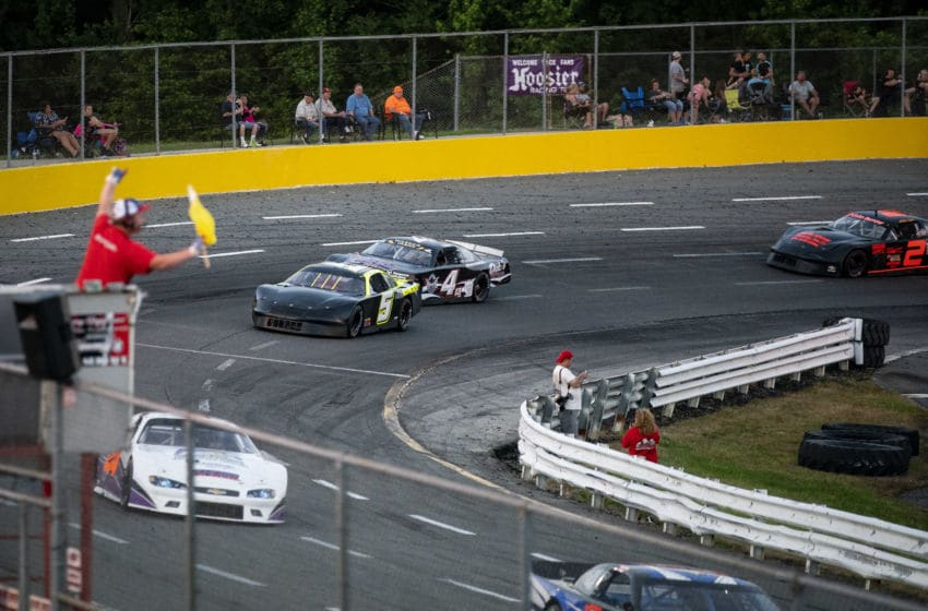 ALTAMAHAW, NC - MAY 30: Cars race at Ace Speedway on May 30, 2020 in Altamahaw, North Carolina. Crowds accumulated at the race track for the second weekend in a row, in defiance of North Carolina Governor Roy Coopers ban on large gatherings due to the coronavirus (COVID-19). (Photo by Al Drago/Getty Images)